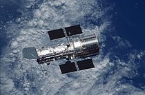 Hubble Space Telescope over Earth (during the STS-109 mission).jpg