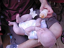 Infant with baby bottle.jpg
