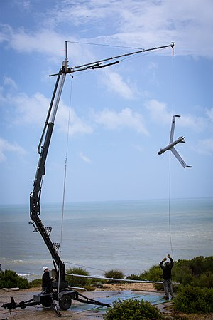 Insitu - A ScanEagle unmanned aircraft is captured by Insitu's patented SkyHook recovery system.