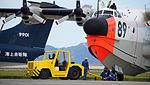JMSDF US-1A(9089) towed by 5t class tractor(MC-0514) at Iwakuni Air Base September 14, 2014 05.jpg