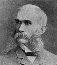 Reavis sporting large sideburns and mustache, dressed in a manner consistent with the peak of his success