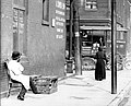 Jewish butcher sits outside his store on St. Louis's north side, probably Franklin Avenue.jpg