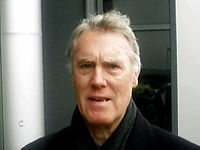 A man wearing a black coat.