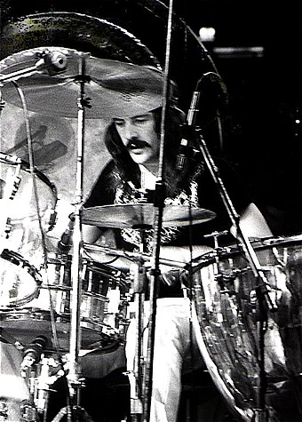 After the death of Bonham (pictured in July 1973) on 25 September 1980, the remaining members of Led Zeppelin decided to disband the group. John Bonham 1975.jpg