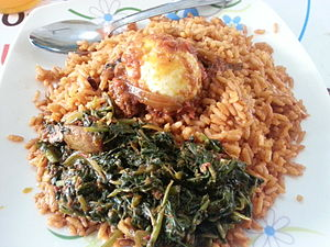 Malian cuisine - Jollof rice with vegetables and a boiled egg