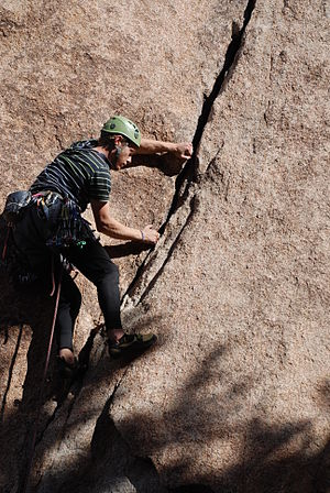 Glossary of climbing terms - Climber's right foot pressing on a rock, is preventing him from barn door swing to the right.