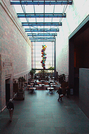 Joslyn Art Museum - From the balcony at the east end of the atrium, one can see another Chihuly work, Glowing Gemstone Polyvitro Chandelier, hanging above the café.
