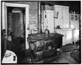 KITCHEN, LOOKING EAST, TOWARD FRONT DOOR - Galbraith House, Montgomery Street, Idaho City, Boise County, ID HABS ID,8-IDCI,3-6.tif