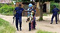 Kananga, Central Kasai, DR Congo- UNPOL and PNC evacuate an old woman who was stabbed by a machete during the attack on the city of Kananga.jpg
