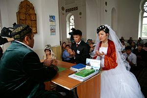 Kazakhs - A Kazakh wedding ceremony in a mosque.