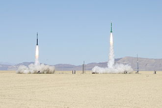 High-power rocketry - Two high-power rockets lift off at the Black Rock Desert in Nevada