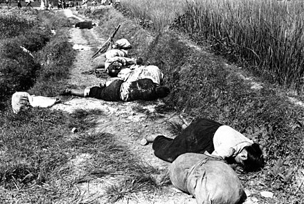 Civilians killed during a night battle near Yongsan, August 1950 Korean civilians fleeing from the North Korean forces, killed when caught in the line of fire during night attack by guerrilla forces near Yongsan HD-SN-99-03166.jpg
