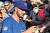 Kris Bryant signing autographs during his rehab assignment against Omaha (44315241021).jpg