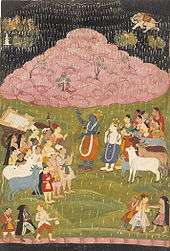 The mountain Govardhan hovers above Krishna and his tribe to protect them from an air attack