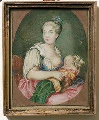 Kvinna med dibarn vid bröstet