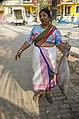 Lady poses with a big fish Velankanni Beach.jpg
