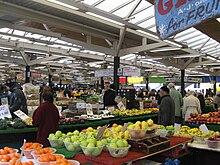 Stalls in Leicester Market selling fruit and vegetables  Market