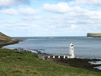 Eday - Lighthouse on Calf Sound, Eday. The land on the upper right of the picture is the northern tip of the Calf of Eday.