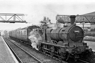 "Llanidloes - Ex-GWR ""Dean Goods"" 2301 Class 0-6-0 No.2483 at Llanidloes railway station passenger train  going towards Builth Wells and Brecon, 29 August 1949"