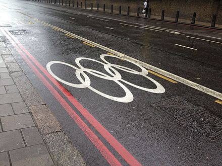 Olympic rings marked on a street, indicating that the lane was reserved for the use of Olympic athletes and staff. London 2012 games lane.jpg