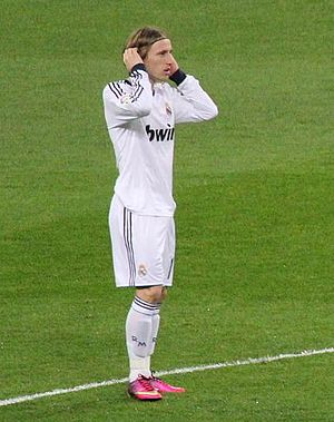 Luka Modrić - Modrić playing for Real Madrid against Sevilla in 2013.