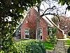 foto van Boerderij met woonhuis tegen topgevel met zesruitsvensters