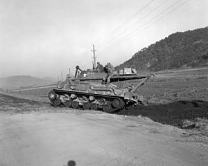 M32 Tank Recovery Vehicle - An M32B1A1 recovery vehicle backing up into a ditch after passing a bridge on the road to Hamhung during the Korean War.