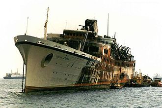 SS Flandre (1951) - Pallas Athena laid up in Perama Bay in 1994 after its fire.