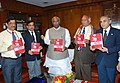 Mallikarjun Kharge releasing a Ruby Jubilee-40th Year Edition of the book titled 'Indian Railway Track', at a function, in New Delhi. The Chairman Railway Board, Shri Arunendra Kumar.jpg
