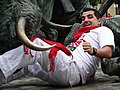 Man Gored by Sculpted Bull - San Fermin Festival - Pamplona - Navarra - Spain (14424587797).jpg