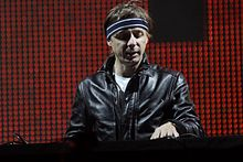 Martin Solveig in a black jacket smiling