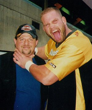 Matt Morgan - Matt Morgan posing with a fan
