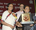 Meira Kumar giving away the Annual Awards of the National Trust (for the welfare of persons with multiple disability) to one of the awardee, in New Delhi on September 22, 2006.jpg