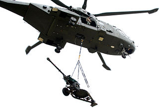 No. 606 Squadron RAF - Merlin Helicopter carrying 105mm Light Gun with staff from No. 606 Squadron