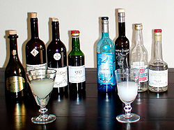 Modern absinthe. Left Vertes, right blanches, with a prepared glass in front of each.