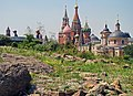 Moscow, Zaryadye Park. View to Saint Basil's Cathedral (at left) and Church of Saint Barbara (at right).jpg