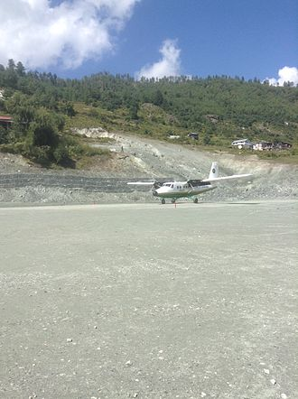 Rara Lake - Tara Air taxiing down the runway in Talcha Airport.