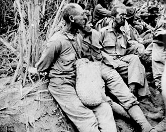 Jose Calugas - Prisoners during the march from Bataan to the prison camp, May 1942. (National Archives)