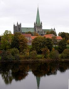 The Nidaros Cathedral, seen from the southern bank of the Nidelven river.