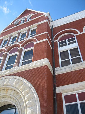 Ogle County Courthouse - The facade of the building is constructed of red brick, accented with limestone detailing.