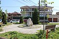 Old stone, public art in a square in the city of Peja.jpg