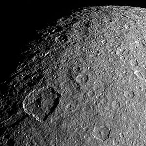 Rhea (moon) - Surface features on Rhea well defined due to the lighting.