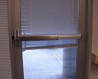 Crash bar - A crash bar fitted to a glass exterior door.