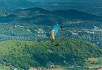 Paraglider in the air (29754737897).jpg