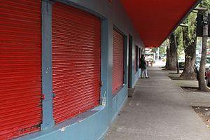 Michoacán Market - Shops with closed doors on sidewalk.