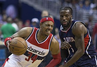 DeMarre Carroll - Carroll (right) with the Hawks in May 2015, defending Paul Pierce of the Washington Wizards