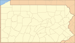 A map of the state of Pennsylvania with a red dot over Lycoming County in the north-central part of the state.