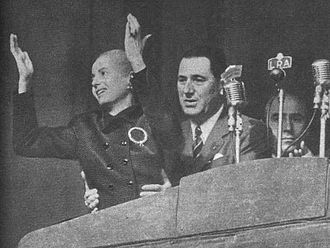Raúl Apold - Evita and Juan Perón at the Plaza de Mayo, 1952. Raul Apold is visible behind Peron.
