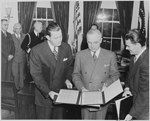 Robert E. Hannegan - Postmaster General Robert E. Hannegan, (left) with the President Harry S. Truman at the Oval Office, in 1946.