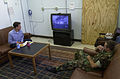 Photographer's Mate 2nd Class Kenney Pace and Journalist 3rd Class Thomas Peterson watch breaking news at Fleet Imaging Command Pacific lounge 010911-N-MJ265-001.jpg